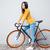 sorrindo · bicicleta · retrato · cinza · olhando - foto stock © deandrobot