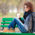woman sitting on the bench and holding cup with coffee stock photo © deandrobot