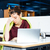 tired business woman in glasses working with laptop on workplace stock photo © deandrobot