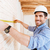 construction worker using measuring tape in a new house stock photo © deandrobot