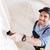 glimlachend · bouwer · verf · binnenshuis · knap · jonge - stockfoto © deandrobot