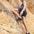 giovane · climbing · muro · shot · posa - foto d'archivio © deandrobot