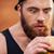 fiatal · éhes · férfi · eszik · szendvics · iroda - stock fotó © deandrobot