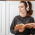 woman listening to music with headphones in the kitchen stock photo © deandrobot