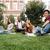 młoda · kobieta · za · pomocą · laptopa · kampus · trawnik · inny · studentów - zdjęcia stock © deandrobot