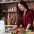 glimlachende · vrouw · met · behulp · van · laptop · groenten · computer · vrouw · voedsel - stockfoto © deandrobot