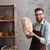 cheerful young man baker standing at bakery holding bread stock photo © deandrobot