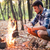 man sitting near bonfire in the forest stock photo © deandrobot