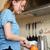 gelukkig · zwangere · vrouw · eten · oranje · home · zwangerschap - stockfoto © deandrobot
