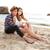 człowiek · wskazując · coś · posiedzenia · sympatia · plaży - zdjęcia stock © deandrobot
