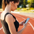 side view of woman resting after run and using smartphone stock photo © deandrobot