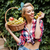 cheerful pin up girl with basket of fruits eating grape stock photo © deandrobot