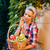 smiling pinup girl sitting and holding basket of fresh fruits stock photo © deandrobot