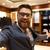 happy businessman showing wardrobe stock photo © deandrobot