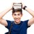 smiling male student holding books on head stock photo © deandrobot