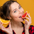 portre · genç · kadın · yeme · greyfurt · gıda · kadın - stok fotoğraf © deandrobot