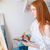 concentrated pensive woman painter with long hair painting on canvas stock photo © deandrobot