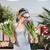 retrato · jovem · bela · mulher · tulipas · buquê - foto stock © deandrobot