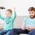 cute · peu · garçon · jouer · jeux · vidéo · famille - photo stock © deandrobot