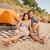 couple having picnic at the beach stock photo © deandrobot