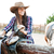happy woman cowgirl smiling and preparing saddle for riding horse stock photo © deandrobot