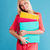 smiling blonde woman in red dress holding colorful folders stock photo © deandrobot