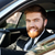 close up portrait of a smiling bearded man in suit driving car stock photo © deandrobot