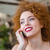 smiling redhead woman talking on the phone stock photo © deandrobot