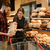 smiling loving couple in supermarket choosing pastries stock photo © deandrobot