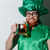 smiling guy in stpatriks costume holding beer stock photo © deandrobot