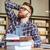 серьезный · молодые · мужчины · студент · изучения · столе - Сток-фото © deandrobot
