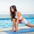 woman doing stretching exercises on yoga mat stock photo © deandrobot