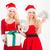 feliz · jovem · irmãs · posando - foto stock © deandrobot