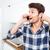feliz · maravilhado · homem · falante · celular · cozinha - foto stock © deandrobot