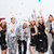 people in santa claus hats drinking champagne and having fun stock photo © deandrobot