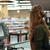Cashier on workspace in supermarket shop. stock photo © deandrobot
