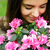 женщину · розовый · цветы · улыбаясь · улыбка - Сток-фото © deandrobot