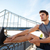sports man doing stretching leaning against the bridge railing stock photo © deandrobot