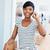 улыбаясь · африканских · деловая · женщина · используя · ноутбук · говорить · сотового · телефона - Сток-фото © deandrobot