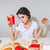 pretty young woman holding french fries and burger stock photo © deandrobot