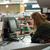 Confused cashier on workspace in supermarket shop. stock photo © deandrobot
