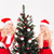 two sisters twins showing silence sign standing near christmas tree stock photo © deandrobot