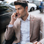 businessman talking on mobile phone sitting outdoors in cafe stock photo © deandrobot