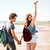 back view of couple with backpacks walking on beach together stock photo © deandrobot