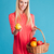 smiling pretty woman holding straw basket with fruits stock photo © deandrobot