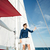 young bearded man standing on a yacht stock photo © deandrobot