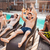 men having fun in swimming pool and drinking beer stock photo © deandrobot