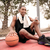 cheerful african basketball player sitting with towel while list stock photo © deandrobot