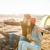 kirándulás · pár · ül · hegy · terep · napos · idő - stock fotó © deandrobot