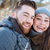 smiling couple standing in winter park stock photo © deandrobot